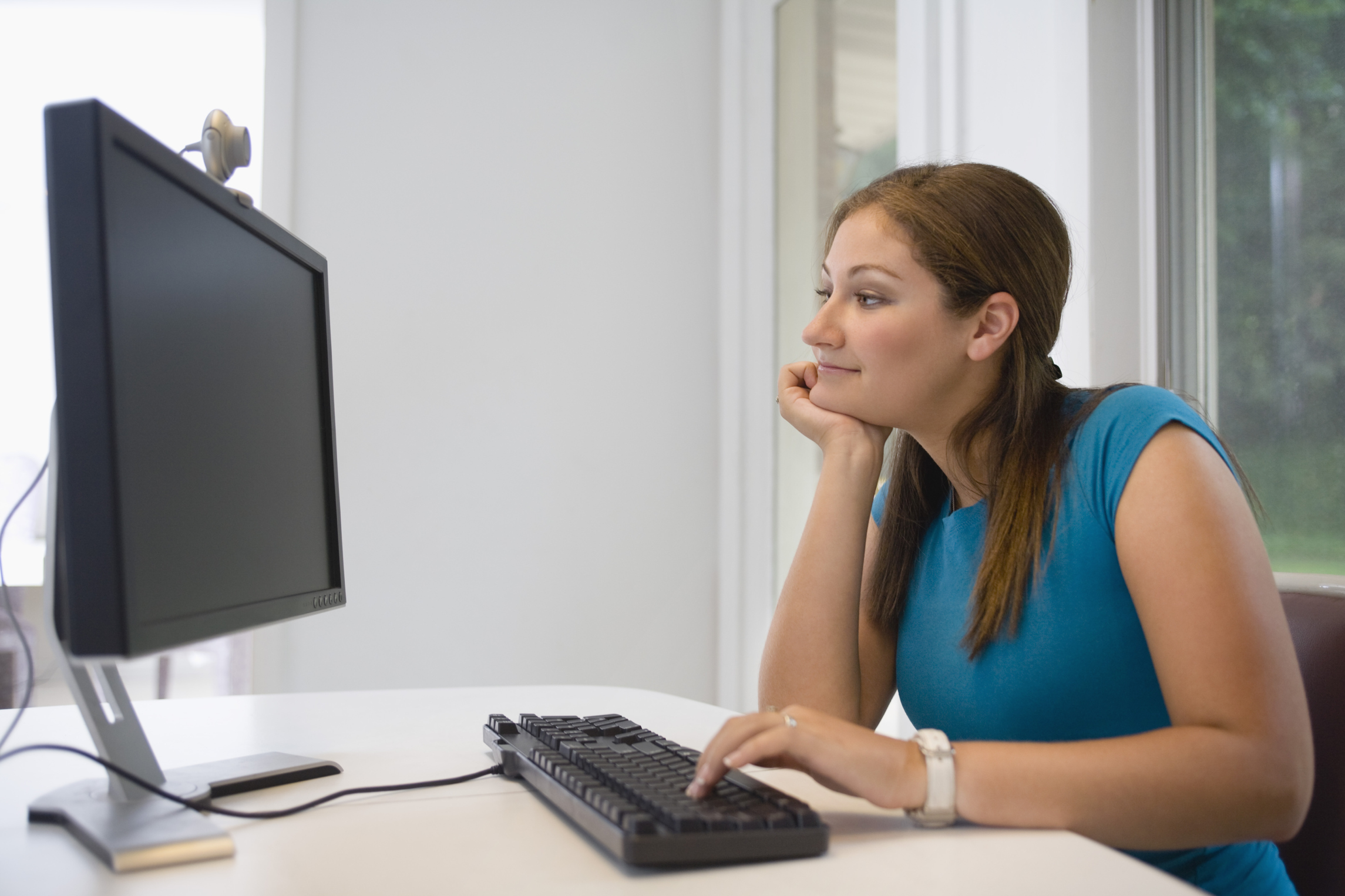 Teen using computer and pointy