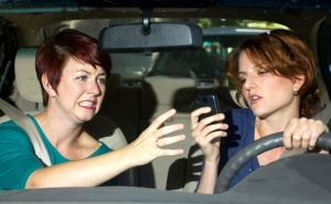 passenger frightened by reckless driver holding a cell phone